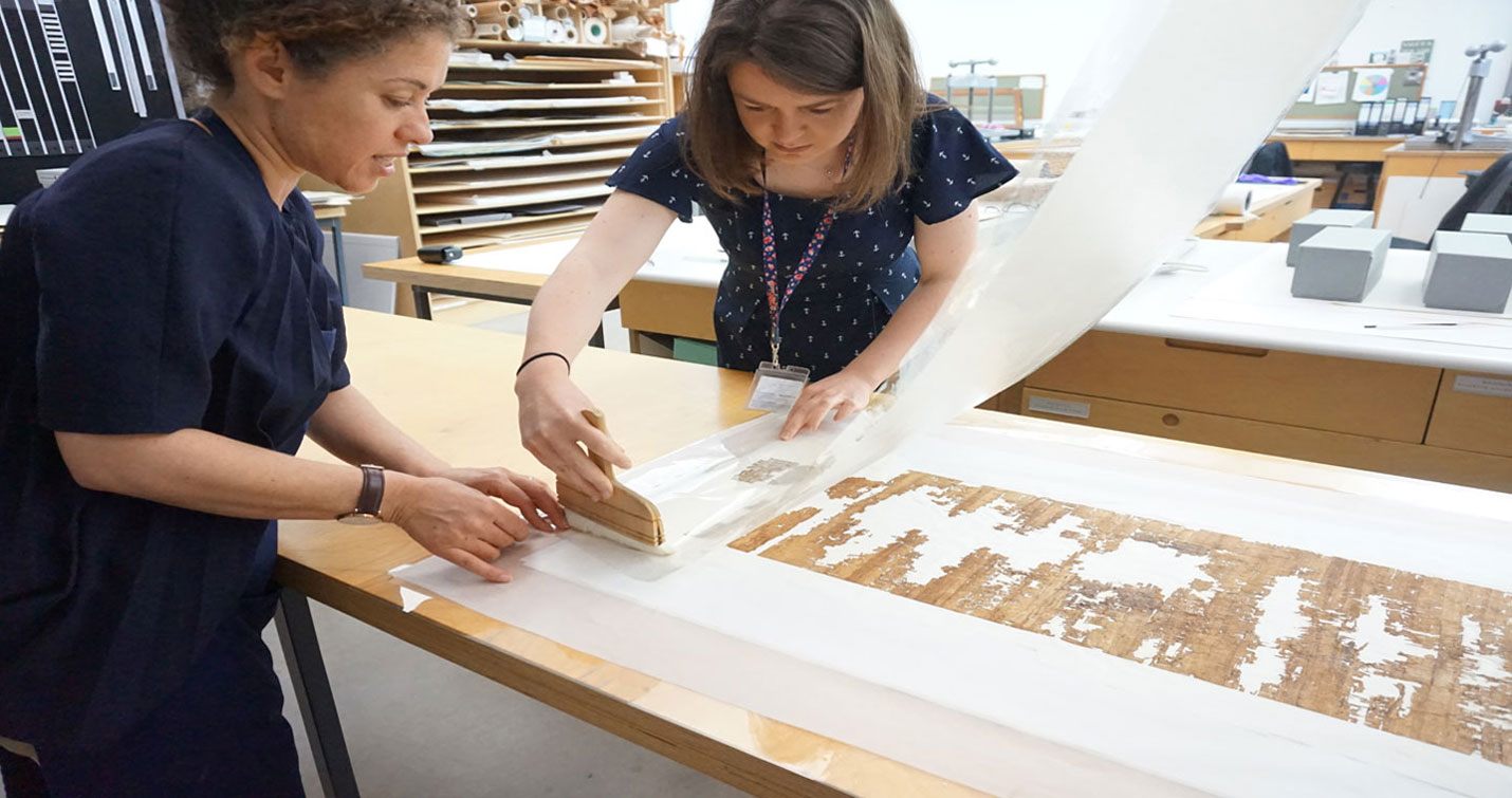 Conservators lining a papyrus. Image courtesy of Trinity College Dublin.